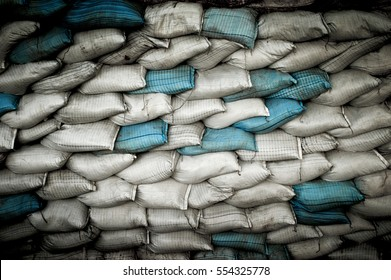Sand bags white and blue made as a wall to block water during floods