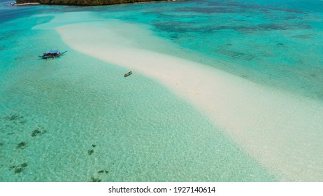 Sand bar in transparent turquoise water top view. Tropical beach with tourists. Mansalangan sandbar, Balabac, Palawan, Philippines. Summer and travel vacation concept - Shutterstock ID 1927140614