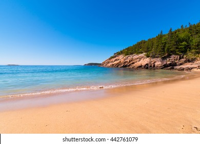Sand Beach at Acadia National Park, Maine. With calm still water.