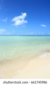 Sand Beach, Blue sky and clear water in resort island in Tahiti