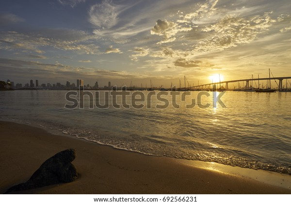 sand, beach, dawn and golden sun at Coronado Bay, San Diego, California