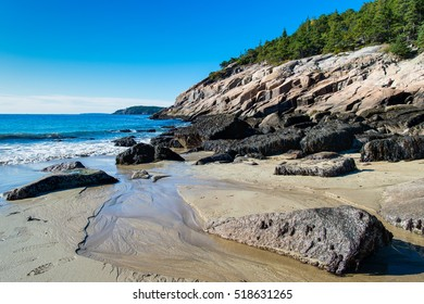 Sand Beach is a gorgeous little beach nestled between mountains and rocky shores on the east side of Mount Desert Island in Acadia National - Bar Harbor, ME, USA