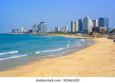 Sand beach and the modern skyline of Tel Aviv city, Israel