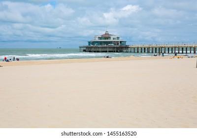 Sand beach and pier in Blankenberge, Flanders, Belgium, 07-15-2019