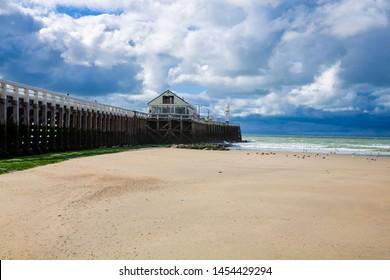 Sand beach and pier on the Atlantic coast in Blankenberge, Flanders, Belgium