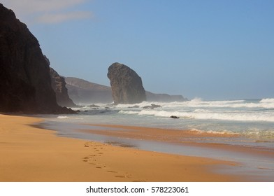 sand beach with rock and ocean