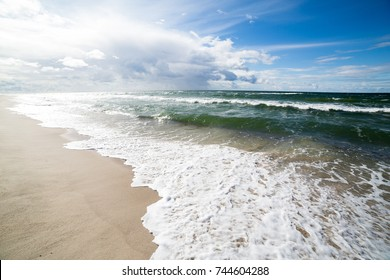 Sand beach and sea waves, Baltic sea seashore. Curonian spit, Kaliningrad region, Russia
