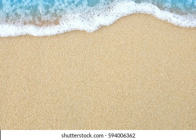 The sand beach with soft wave.