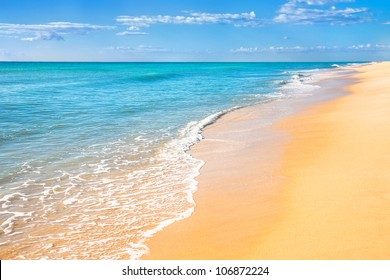 Sand beach with surf water background