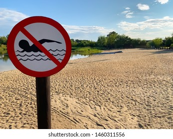 sand beach. swimming is prohibited. green vegetation.