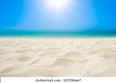 Sand beach and tropical sea with bright sun