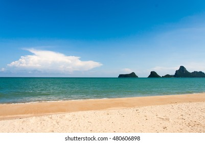 Sand beach and tropical sea at sunny day.