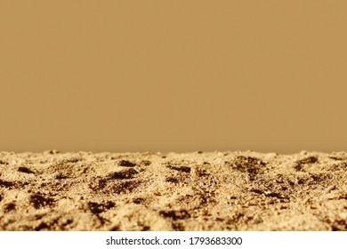 Sand with beige background, hard sunlight. Horizontal template for banner with copy space. Monochrome brown mockup for natural organic product, eco cosmetic. Desert and drought concept. Sultry mood