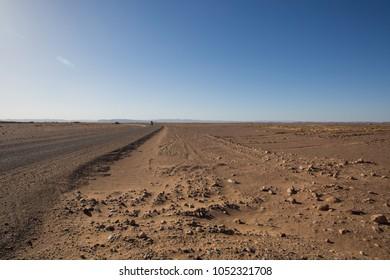 Sand and blue sky in desert. Sahara, Morocco.