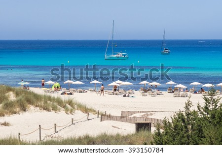 The sand and the blue waters of Cala Saona beach, Formentera, Spain