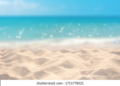 Sand with blurred tropical sandy beach bokeh background, Summer vacation and product advertisement concept
