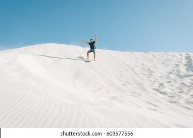 Sand boarding crash at the Lancelin sand dunes near Perth, Western Australia