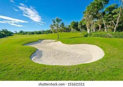 Sand bunker on the beautiful golf course. Mexican resort. Bahia Principe.  Riviera Maya.