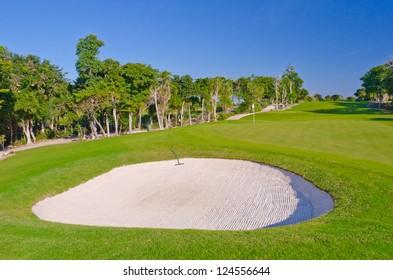 Sand bunker on the golf course. Mexican resort. Bahia Principe, Riviera Maya.
