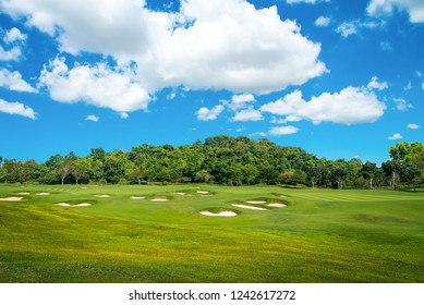 Sand bunkers on the golf course with blue sky background.