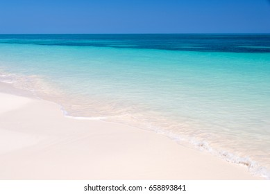 Sand and caribbean sea background, tropical beach travel concept