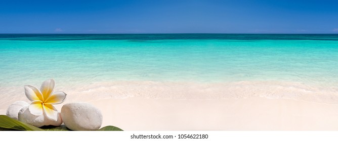 Sand and caribbean sea panoramic background, summer and travel concept