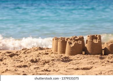 Sand castle. Sand figures on the beach. Beach. Vacation at sea. Summer.