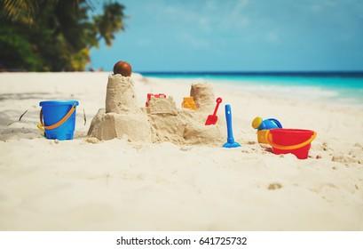 Sand castle on beach and kids toys