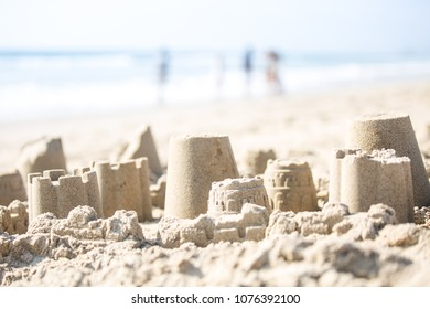 Sand Castles on the Beach with people in the background