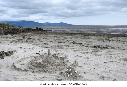 Sand castles on Blackrock Beach in Dundalk, County Louth with the Cooley Mountains in the distant background.