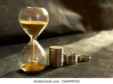 Sand clock with Thai coin currency. Time is money, investment concept