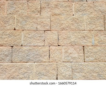 Sand color cracked retention wall blocks and bricks