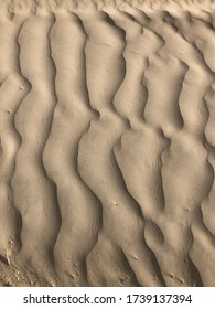 Sand contours making an abstract pattern