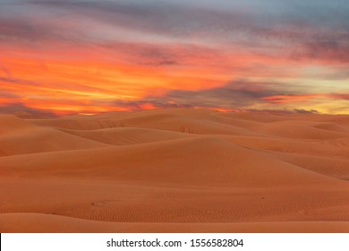 Sand desert dunes sunset landscape view, picturesque sunset landscape, UAE.