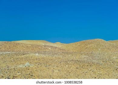 sand and dessert against deep blue sky