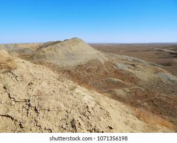 Sand dumps near an abandoned uranium quarry. Kazakhstan. Mangistau region.