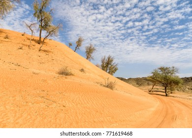 A sand dune close to Wadi Maidaq, Fujairah, UAE in an off road track. This is where sand and rocks meet in UAE.