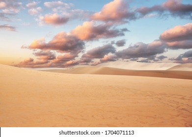 Sand dune with colorful cloud in sky on desert at evening