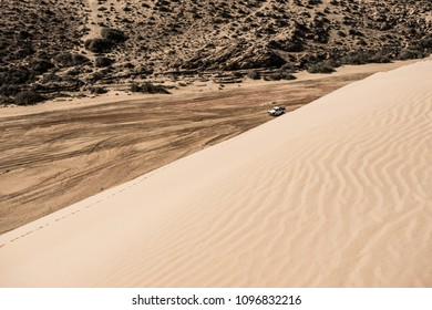 Sand dune and dry river bed, Sahara Desert, Morocco.