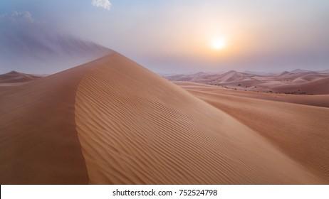 Sand Dunes in Abu Dhabi desert with an amazing sunset. Al Qua`a desert, Unite Arab Emirates