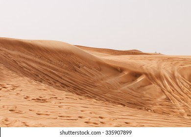 Sand dunes of the Arabian desert, close to Dubai in the United Arab Emirates. Soft vintage editing. Picture taken on a desert safari.