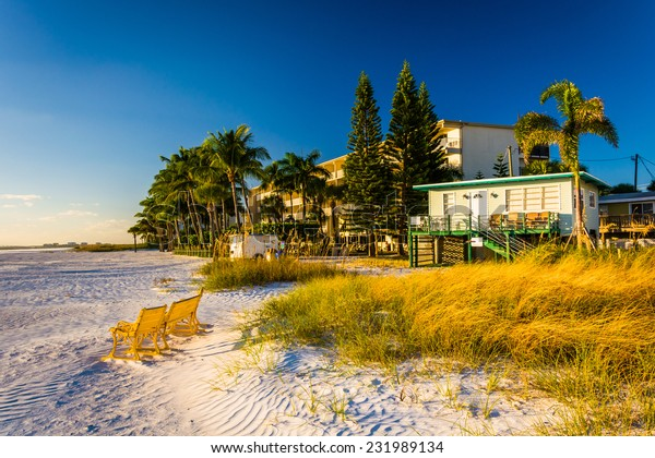 Sand dunes and buildings on the beach in Fort Myers Beach, Florida.