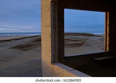 Sand dunes by the house on the beach, France