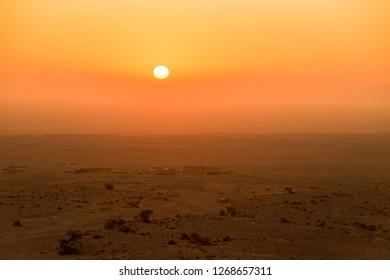Sand dunes desert near westward Neimenggu with sunset.