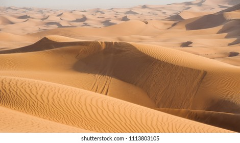 Sand dunes in Dubai desert with tire tracks  after off road jeep safari