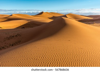 Sand dunes in Erg Chigaga with blue sky, Morocco