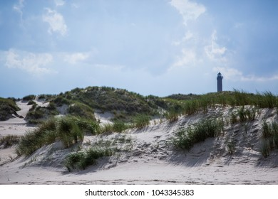 Sand dunes with lighthouse in the background Norderney beach
