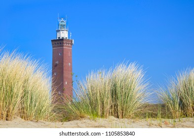 Sand Dunes with lighthouse in thebackground. Ouddorp, Holland