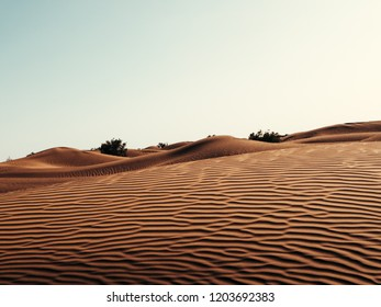 Sand Dunes in the Moroccan Part of Sahara Desert, with blue sky.