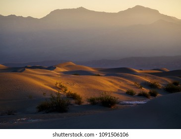 Sand Dunes And Mountains in sunrise, Death Valley National Park, California, USA